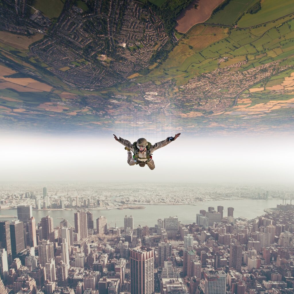 image showing a man in a parachute flowing in the air